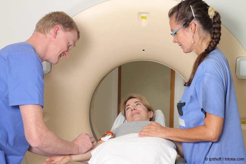 Radiologist administers contrast agent to patient for MRI examination as example of use of barium sulfate in contrast agents